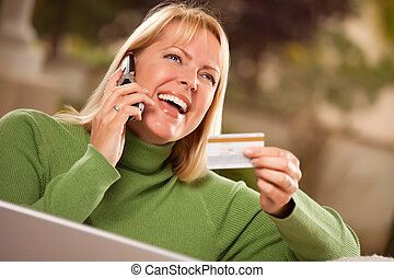 Cheerful Woman on Phone and Laptop with Credit Card -...