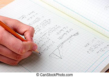 Mathematical problem - Human hand with a pencil over a...
