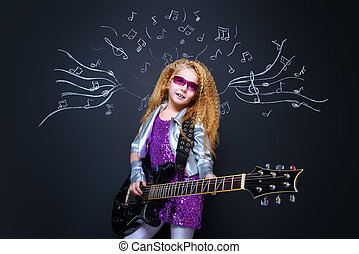 popular music - Little rock star singing with her electric...