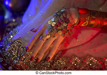 Golden Oriental Jewelry and Accessories: Female Hands with India