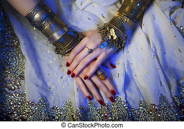 Bridal Oriental Jewelry and Accessories: Female Hands with...