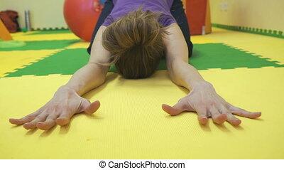 Girl yoga instructor does exercises - Girl yoga instructor...