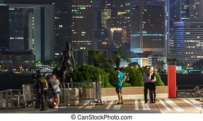 Statue and skyline in Avenue of Stars timelapse in Hong...