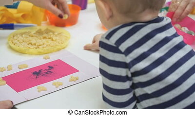 Child playing intellectual game at a nursery school
