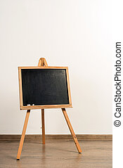 Wooden painter tripod easel on white wall