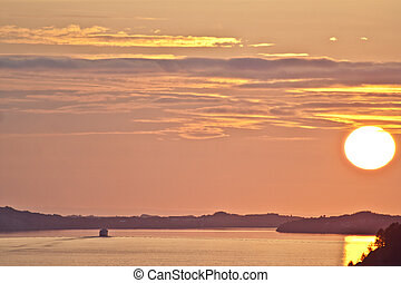 ship going into fabulous golden sunset norway