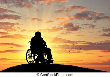 Silhouette of disabled person in a wheelchair - Concept of...
