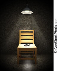 Interrogation room with one wooden chair illuminated with...