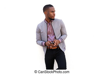 Handsome african guy holding a cell phone and looking away -...
