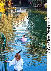 Christian pilgrims baptized in Jordan River - Christian...