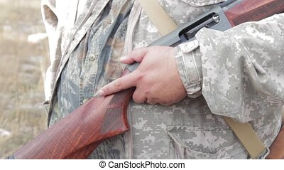 Hunter keeps a shotgun - Hunter holding a rifle butt for