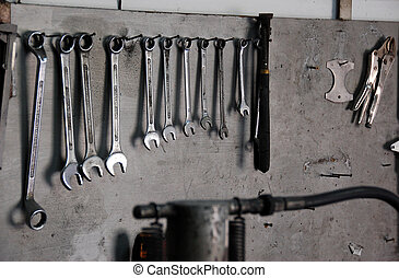 Tools on wooden board - mechanic tools hanging on a...
