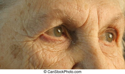 Close-up portrait of a old womans gaze,