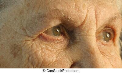 Close-up portrait of a old woman's gaze,