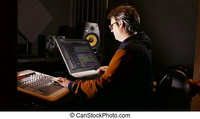 man sound designer in his recording studio - man sound...