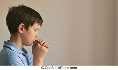 bot teen praying on black background - bot teen praying on...