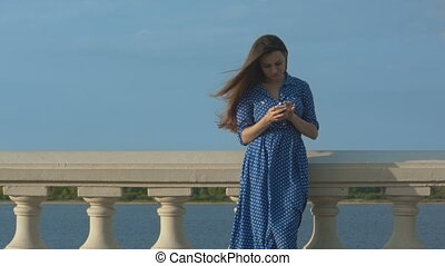 young woman checking her messages.
