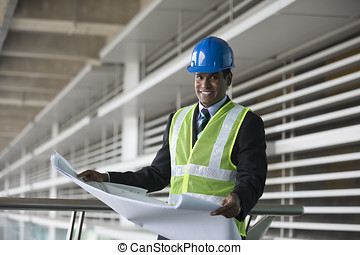 Indian Architect or industrial engineer at work. - Portrait...