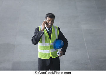 Above view of an Indian Architect or engineer. - High angle...