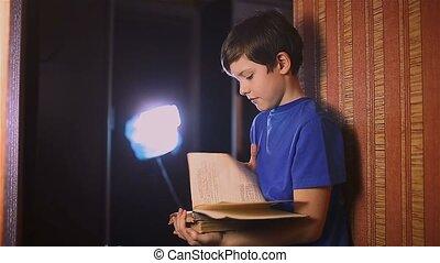 boy teen reading education book is wall indoor - boy teen...