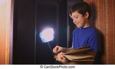 teen education boy reading book is wall indoor - teen...