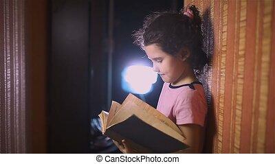 teen girl reading book is wall indoor education