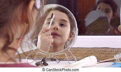 teen girl doing indoor makeup eyebrow comb - teen girl doing...