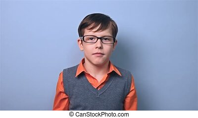 boy with glasses schoolboy surprise at school board - boy...