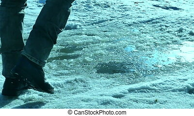 man goes on travel journey in winter snow puddle - man goes...