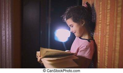 teen girl reading book is wall education indoor