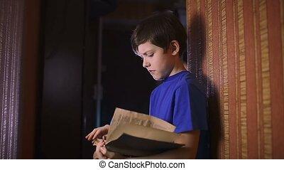 teen boy reading book education is wall indoor - teen boy...