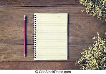 Blank Small notepad and pencil on the wooden table. View...