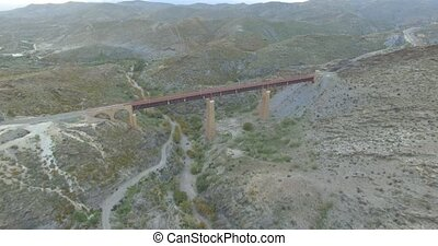 4K Flight over a railroad bridge - Shot is straight out of...