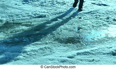 man goes on travel journey in winter puddle snow - man goes...