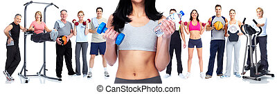 Healthy woman with dumbbell.