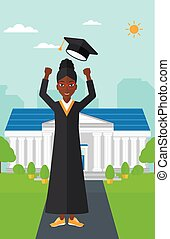 Graduate throwing up his hat. - An african-american happy...