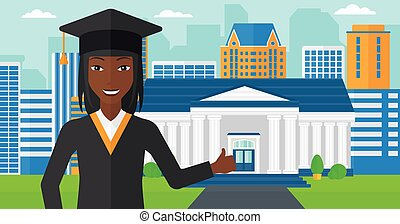 Graduate showing thumb up sign - An african-american woman...