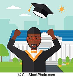 Graduate throwing up his hat - An african-american graduate...