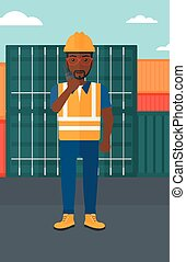 Stevedore standing on cargo containers background - An...