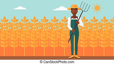 Farmer with pitchfork. - An african-american woman standing...
