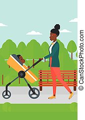 Woman pushing pram. - An african-american mother walking...