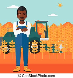 Man standing with combine on background - An...