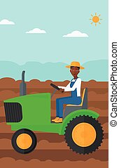 Farmer driving tractor. - An african-american woman driving...