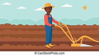 Farmer on the field with plough. - An african-american man...