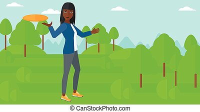 Woman playing frisbee. - An african-american woman playing...