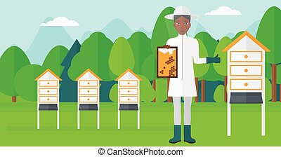Bee-keeper at apiary. - An african-american woman wearing...