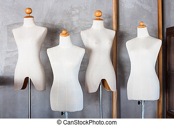 Mannequin tailors in storage room, stock photo