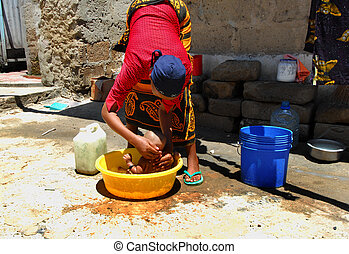 africa - African mother washes her son
