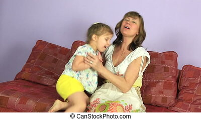 Happy joyful woman hugging little granddaughter - Happy...