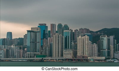 Hong Kong skyline in the morning over Victoria Harbour timelapse.